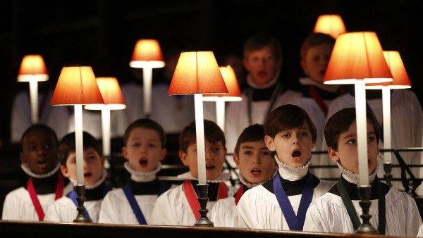 Choristers of St Paul's Cathedral practice in the choir stalls of the cathedral in the City of London