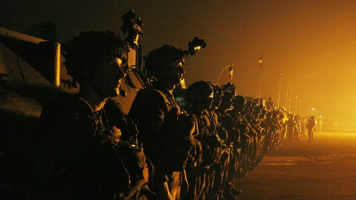 French troops stand at the airport runway in Bangui