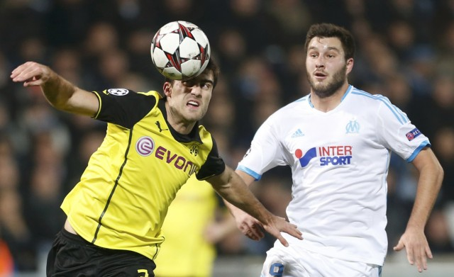 Olympique Marseille's Gignac challenges Borussia Dortmund's Papastathopoulos during their Champions League soccer match in Marseille