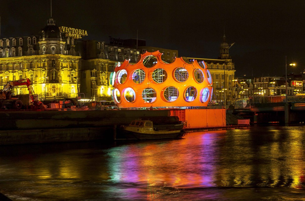 The orange 'Fly's Eye Dome' by Buckminster Fuller is pictured on display as part of the Amsterdam Light Festival in Amsterdam