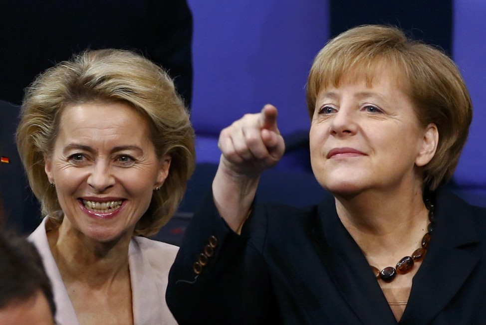 German Chancellor Merkel gesture as she stands besides  Defence Minister Von der Leyen smiles as she arrives for Bundestag meeting to elect Chancellor in Berlin