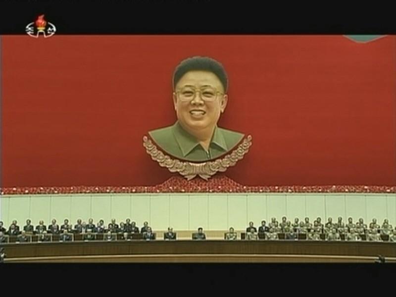 Still image from video of North Korean leader Kim Jong Un attending a mass indoor memorial rally in Pyongyang