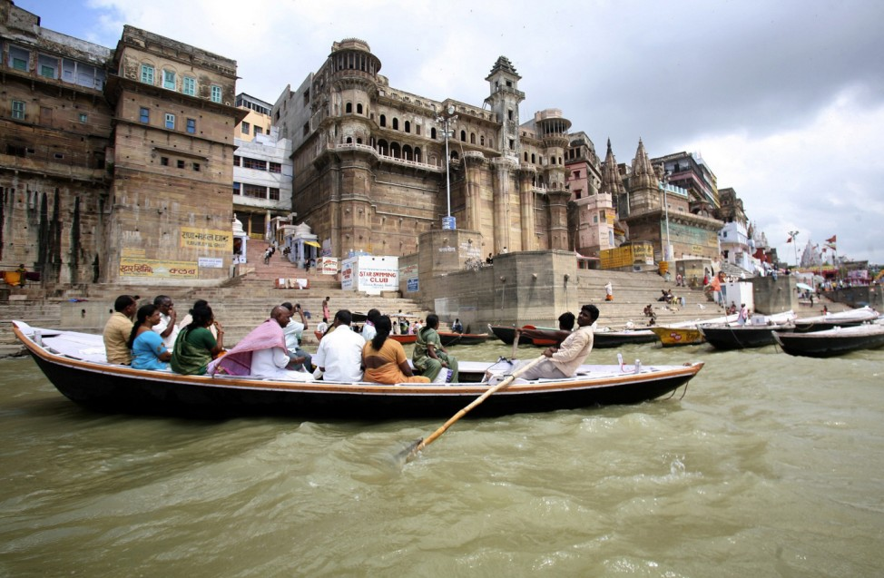 A boatman rows a boat on the waters of the river Ganges past holy 'ghats' (banks) in the northern Indian city of Varanasi
