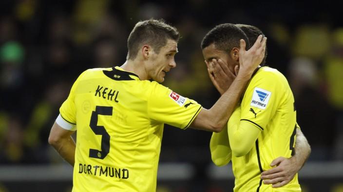 Borussia Dortmund's Kehl reacts to Sarr during the German first division Bundesliga soccer match against Hertha Berlin in Dortmund