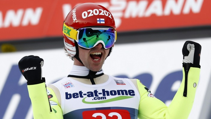 Finland's Koivuranta celebrates after winning the third jumping of the four-hills tournament in Innsbruck