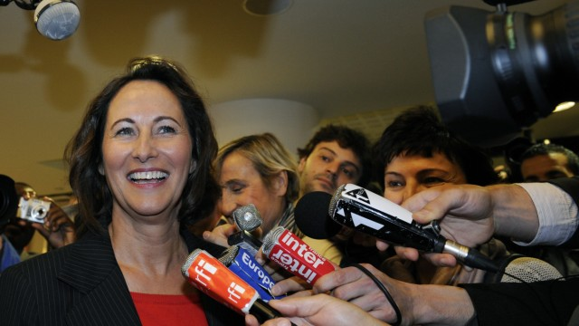 Segolene Royal, French Socialist Party member and Poitou-Charentes' regional president speaks with journalists as she arrives to attend the party's national convention meeting in La Defence near Paris