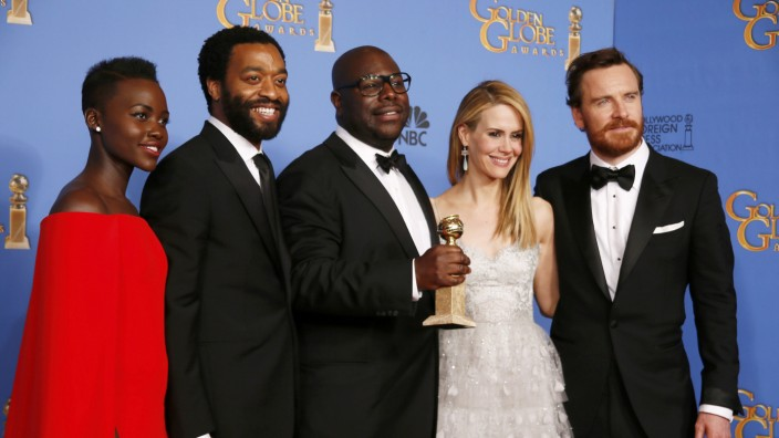 Actress Nyong'o, actor Ejiotor, director McQueen, actress Paulson and actor Fassbender pose backstage with their Best Motion Picture - Drama award for the film '12 Years a Slave' at the 71st annual Golden Globe Awards in Beverly Hills
