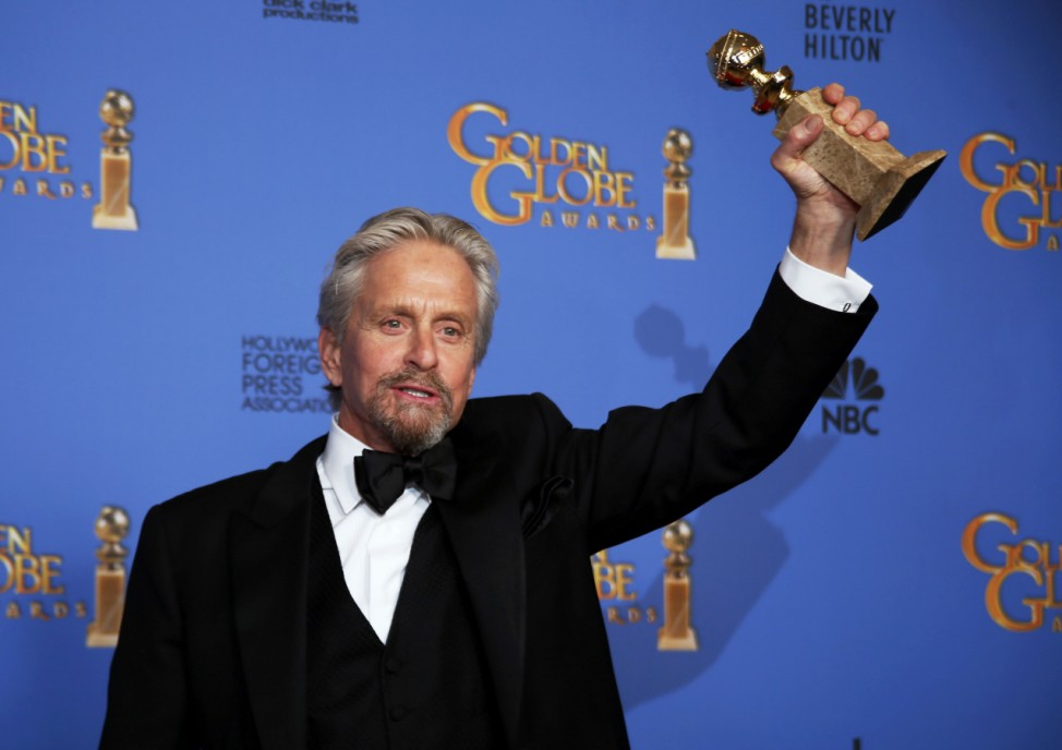 Michael Douglas poses backstage with his award at the 71st annual Golden Globe Awards in Beverly Hills