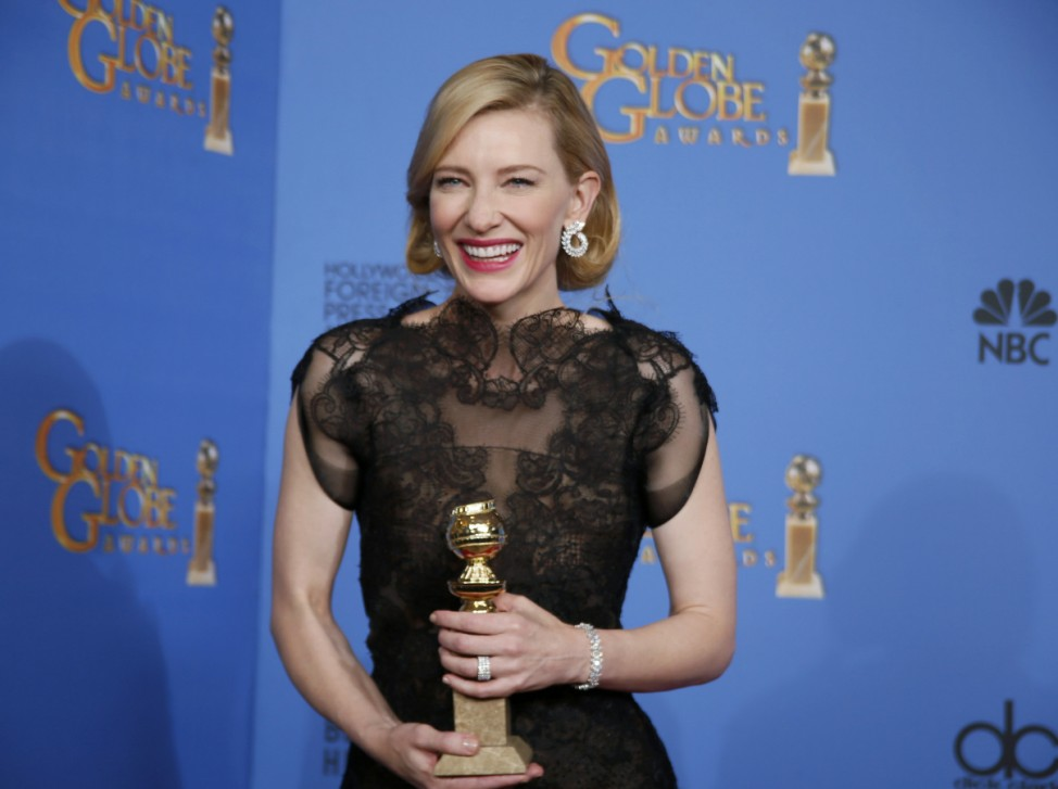 Actress Cate Blanchett poses backstage with her Best Performance by an Actress in a Motion Picture - Drama Award for 'Blue Jasmine' at the 71st annual Golden Globe Awards in Beverly Hills