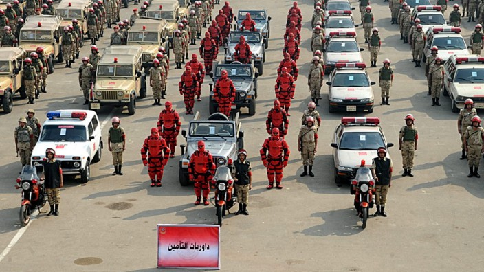 Egyptian security patrol whose members are dressed in red outfits