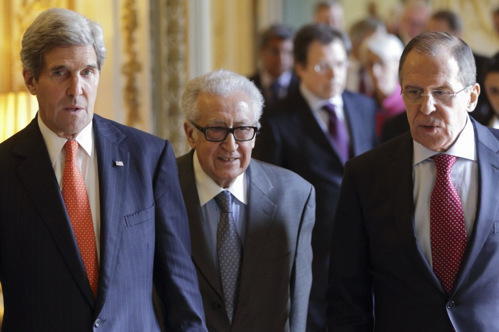 US Secretary of State Kerry, UN-Arab League envoy for Syria, Brahimi and Russia's Foreign Minister Lavrov arrive at a news conference in Paris