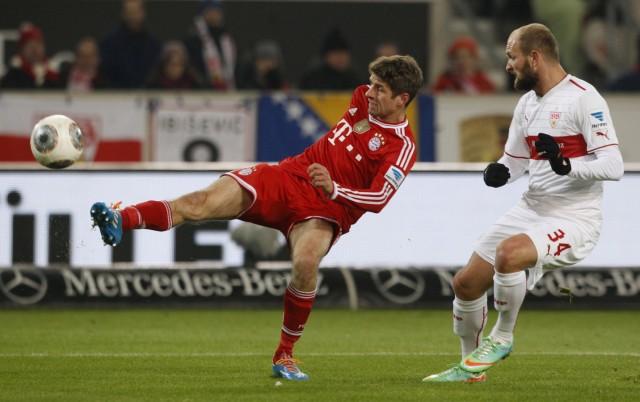 Bayern Munich's Mueller tries to score against Stuttgart's Rausch during German first division Bundesliga soccer match in Stuttgart