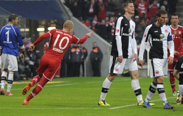 Bayern Munich's Robben celebrates a goal against Eintracht Frankfurt during the German first division Bundesliga soccer match next to Eintracht's Madlung und Jung in Munich