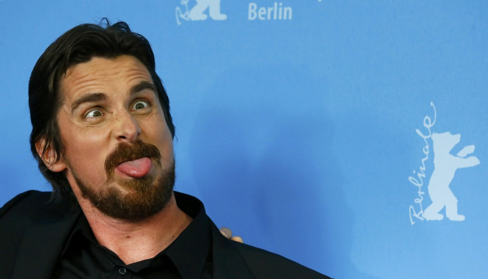 Actor Bale poses to promote movie American Hustle at 64th Berlinale International Film Festival in Berlin