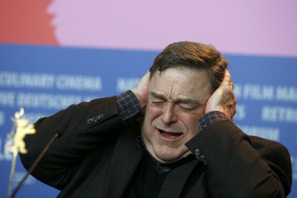 Cast member Goodman reacts during news conference at 64th Berlinale International Film Festival in Berlin