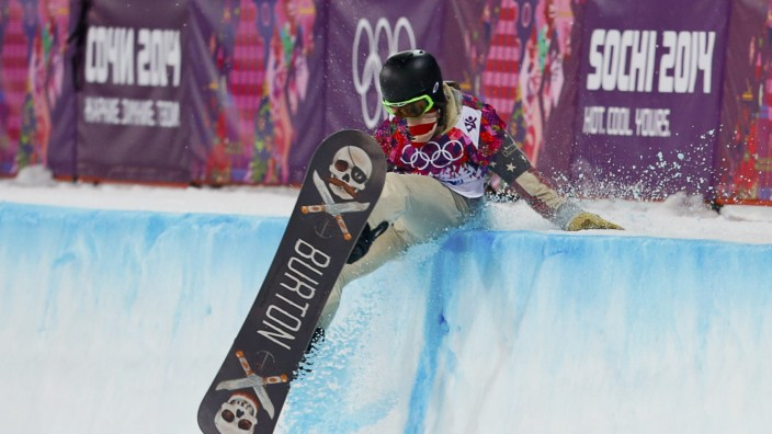 White of the U.S. crashes during the men's snowboard halfpipe final event at the 2014 Sochi Winter Olympic Games, in Rosa Khutor