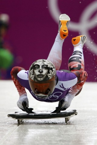 Canada's Reid speeds down the track during a women's skeleton training event at the Sanki Sliding Center