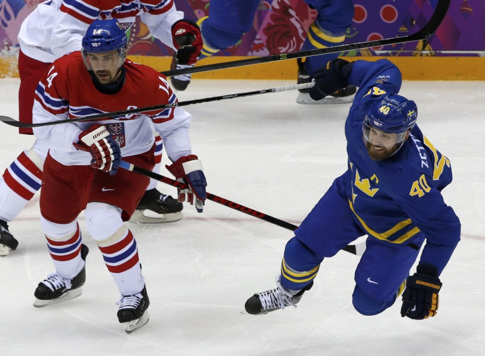 Plekanec of the Czech Republic trips up Zetterberg of Sweden during the second period of their men's preliminary round hockey game at the 2014 Sochi Winter Olympic Games