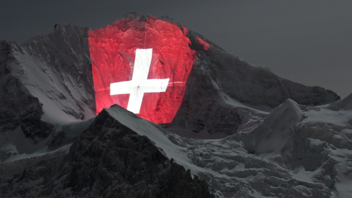 File photo of giant light installation of the flag of Switzerland on north face of the Jungfrau mountain