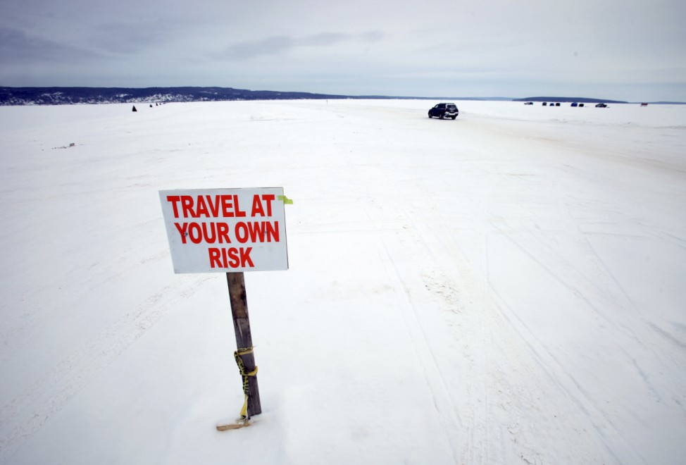 Car travels the ice road on Lake Superior between Bayfield, Wisconsin and Madeline Island