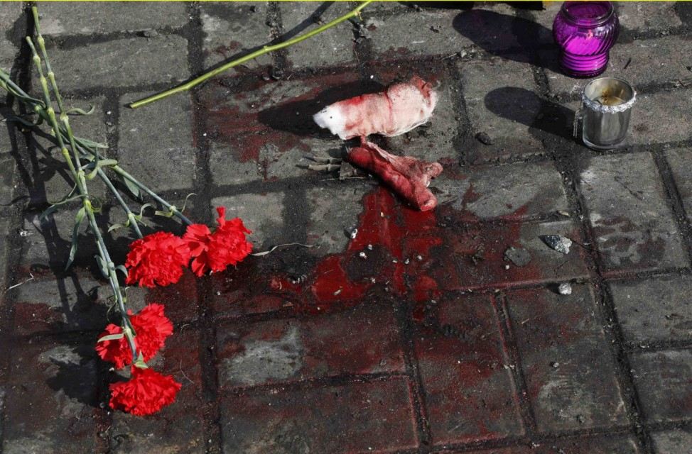 Flowers are pictured placed at the spot where an anti-government protester was killed in Thursday's clashes with riot police in Kiev