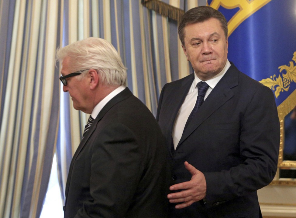 Ukraine's President Yanukovich and Germany' Foreign Minister Steinmeier arrive for a signing ceremony of an EU-mediated peace deal with opposition leaders in Kiev