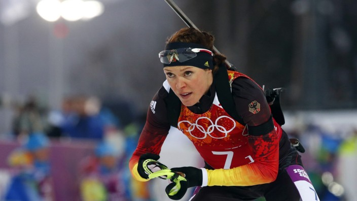 File picture shows Germany's Sachenbacher-Stehle leaving shooting range during mixed biathlon relay at 2014 Sochi Olympic Games