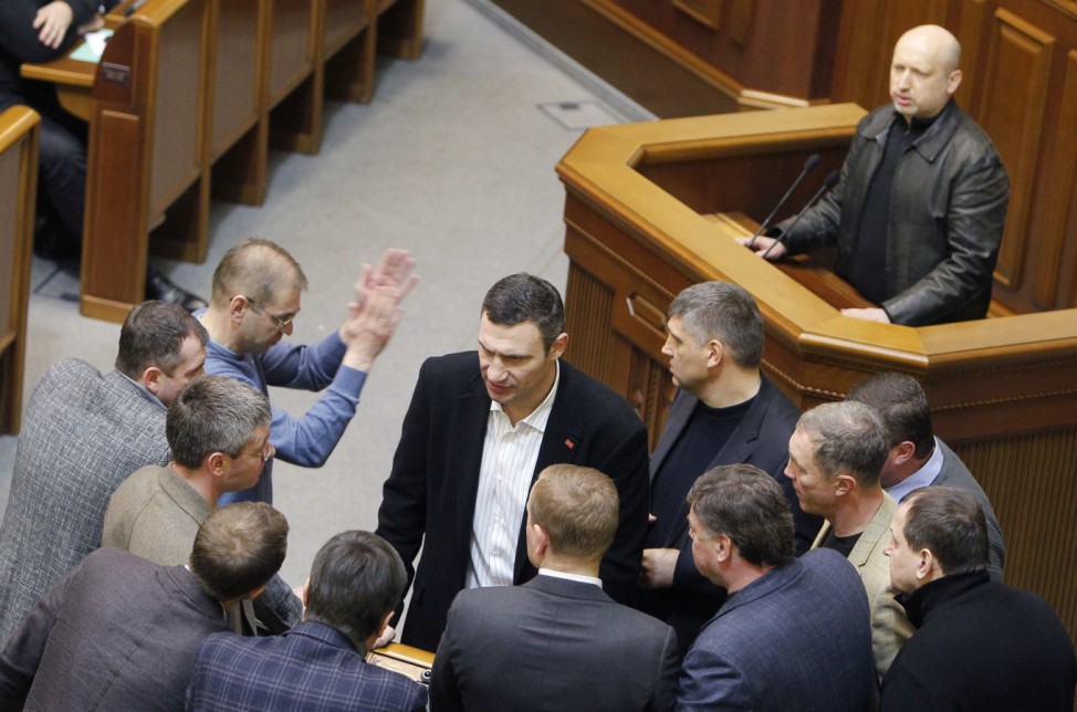 Ukrainian opposition leader and head of the UDAR (Punch) party Vitaly Klitschko talks to his colleagues, with newly elected speaker of parliament Oleksander Turchynov seen in the background, in Kiev