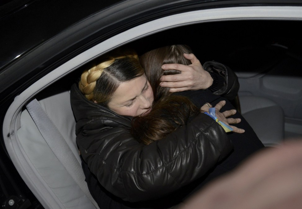 Ukrainian opposition leader Tymoshenko hugs her daughter Yevgenia upon arrival at the airport in Kiev