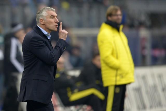 Hamburg SV's new head coach Slomka reacts during the German Bundesliga first division soccer match against Borussia Dortmund in Hamburg