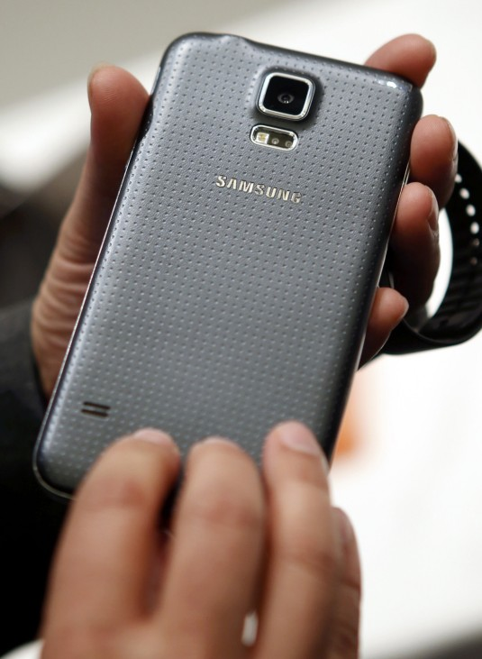 A new Samsung Galaxy S5 smartphone is displayed at the Mobile World Congress in Barcelona