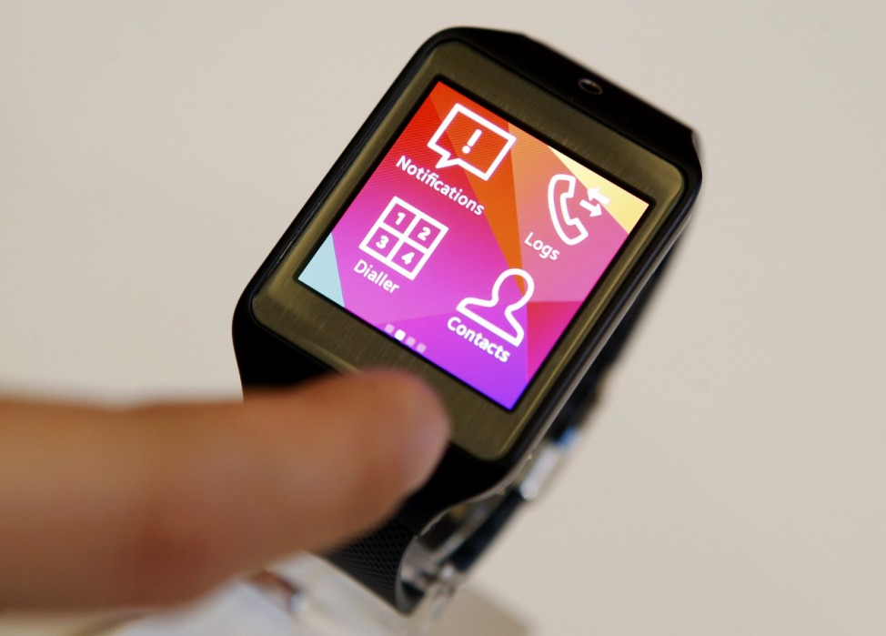 New Samsung Gear 2 smartwatch is seen on a display at the Mobile World Congress in Barcelona