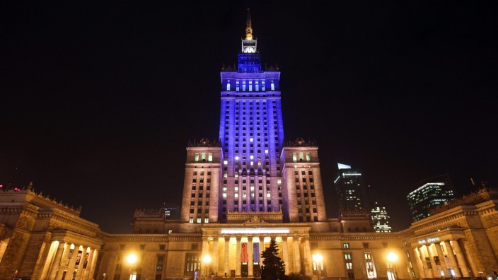 Palace of Culture and Science illuminated in blue and yellow