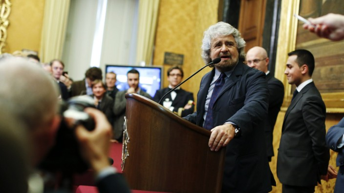 Leader of '5-Star' movement and comedian Grillo talks to reporters at the end of the consultations with Italian Prime Minister-designate Renzi at the Parliament in Rome