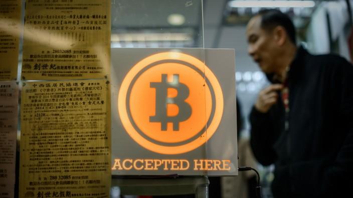 Online-Zahlungssystem: Auch in der Offline-Welt akzeptieren mehr und mehr Läden Bitcoins, hier ein Shop in Hongkong.
