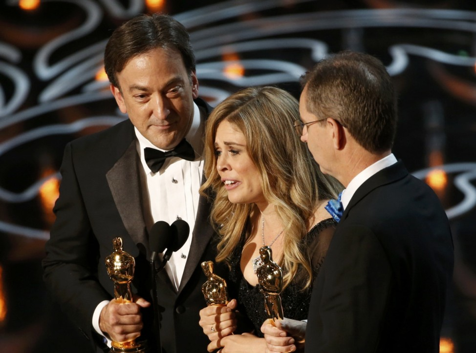 Del Vecho, Lee and Buck accept the Oscar for best animated feature film for 'Frozen' at the 86th Academy Awards in Hollywood