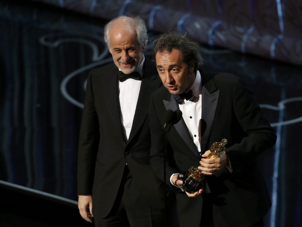 Director Sorrentino actor and Servillo accept the Oscar for best foreign language film for the Italian movie 'The Great Beauty' at the 86th Academy Awards in Hollywood