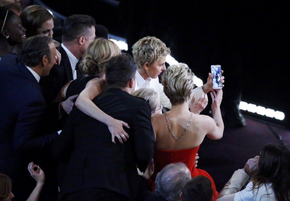 Host Degeneres takes a group picture at the 86th Academy Awards in Hollywood