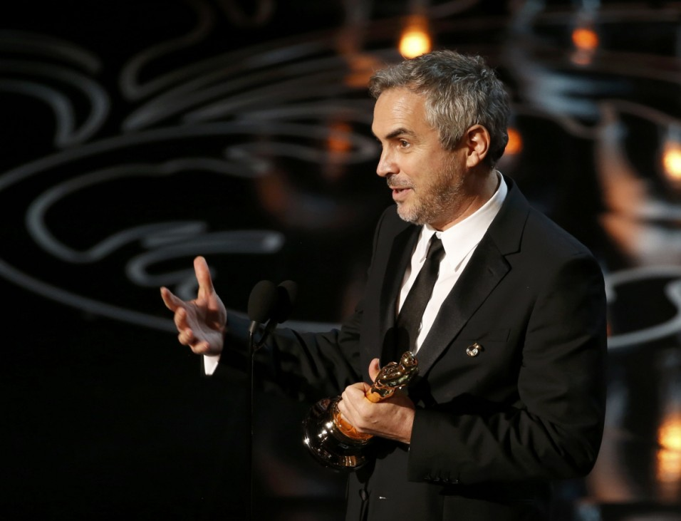 Alfonso Cuaron accepts the Oscar for best director for 'Gravity' at the 86th Academy Awards in Hollywood