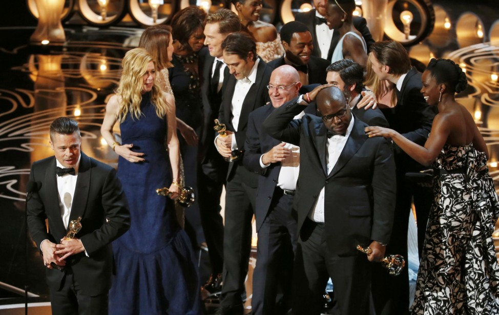 Pitt and the rest of the cast including director and producer McQueen accept the Oscar for best picture at the 86th Academy Awards in Hollywood
