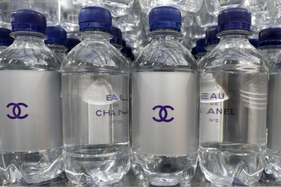 Chanel mineral bottles are displayed on supermarket shelves at the Grand Palais transformed into a 'Chanel Shopping Center' during Paris Fashion Week