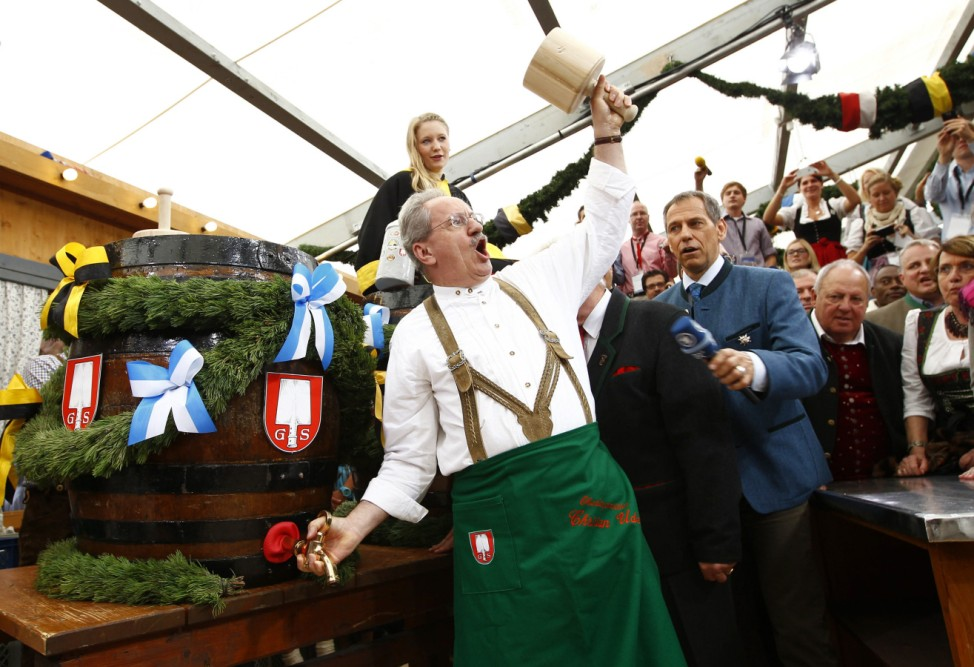 Munich Mayor Ude taps first barrel of beer during opening ceremony for 180th Oktoberfest in Munich