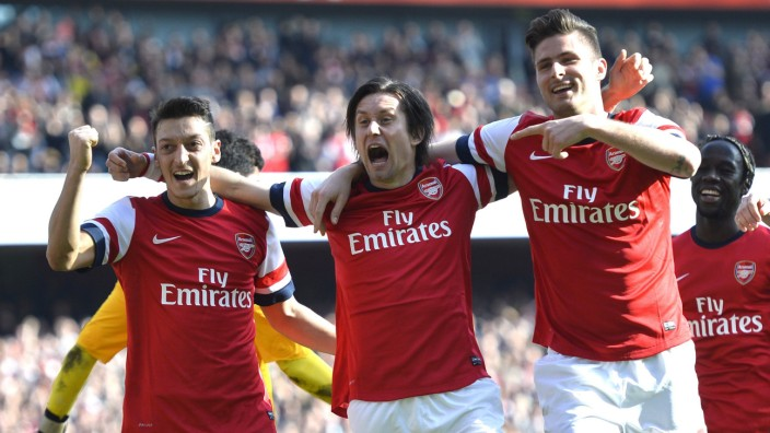 Arsenal's Ozil, Rosicky and Giroud celebrate Giroud's goal against Everton during their English FA Cup quarter final soccer match at the Emirates stadium in London