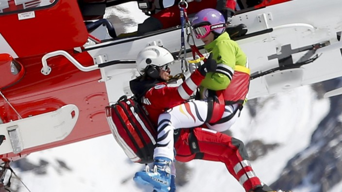 Germany's Hoefl-Riesch is rescued by a helicopter following her crash at the season's last women's downhill race at the FIS Alpine Skiing World Cup finals in the Swiss ski resort of Lenzerheide