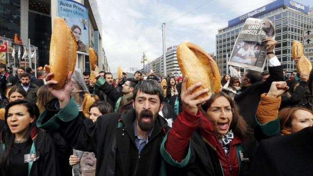 Anti-government protesters carry bread during a demonstration marking the funeral of Berkin Elvan in Ankara