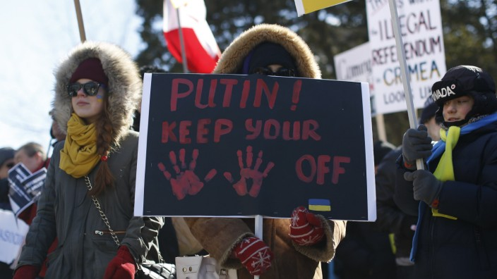 Demonstrators take part in a protest against the referendum in Ukraine's Crimea region, outside the Russian embassy in Ottawa