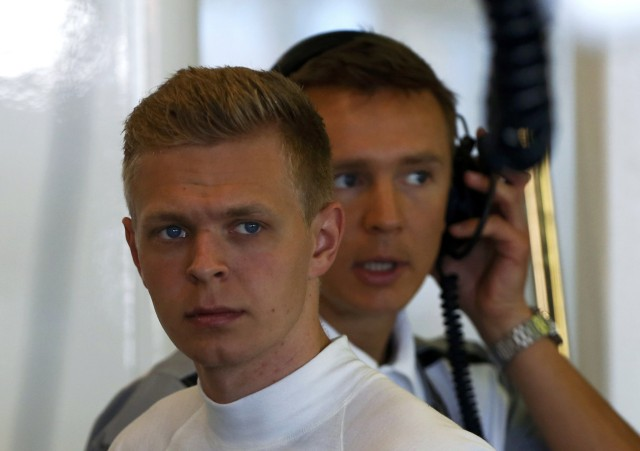 McLaren Formula One driver Magnussen of Denmark looks on in the garage during the first practice session of the Australian F1 Grand Prix in Melbourne
