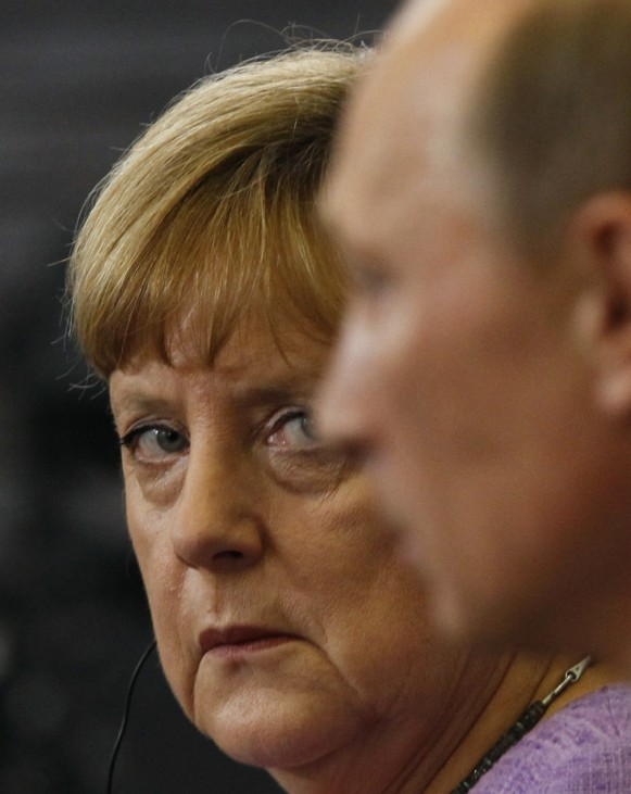 File photo of Russia's President Putin and Germany's Chancellor Merkel attending a news conference in St. Petersburg