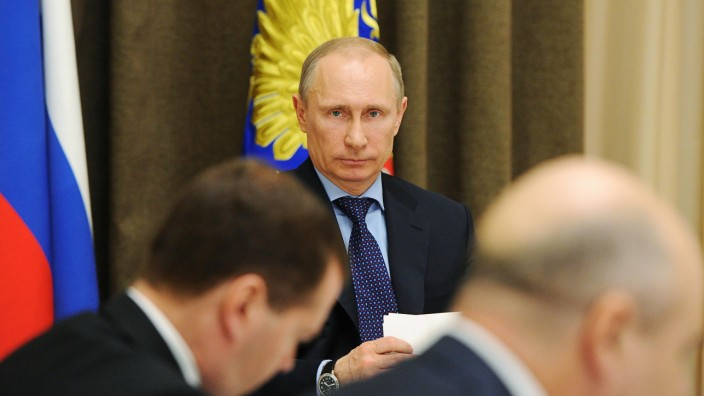 Russian President Putin looks on during a meeting with economic advisors at the Bocharov Ruchei state residence in Sochi
