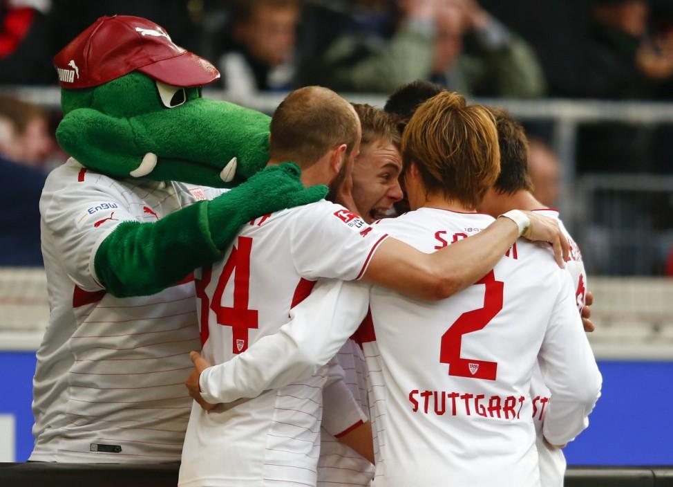 Stuttgart's Maxim celebrates his goal against Hamburg with teammates during their German first division Bundesliga soccer match in Stuttgart